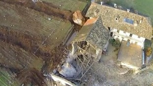 An aerial view of the devastated barn