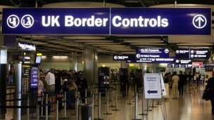 A UK Border Control checkpoint at an airport.