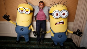 Actor Steve Carell poses with two life-size minion characters