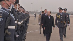 President Francois Hollande and David Cameron take part in a kit inspection.