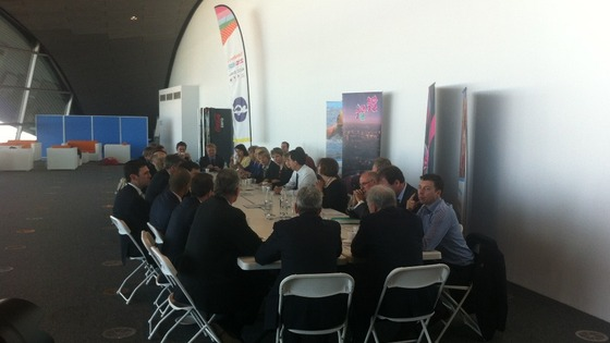 The shadow cabinet seated round a table.