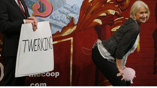 """Actress Helen Mirren acts out """"twerking"""" in a game of charades at Harvard University in the US"""
