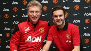 Juan Mata signing his Manchester United contract with David Moyes