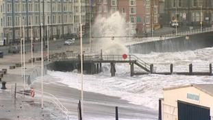 Large waves crash against Aberystwyth promenade