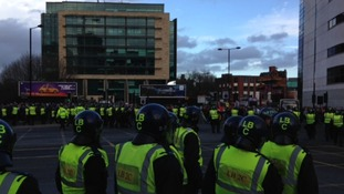 Lines of police officers monitor the crowds after Tyne-Wear derby.