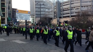 Police escort fans away from St James' Park, Newcastle.