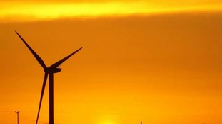 Sunset with wind turbine at Chatteris Fen in Cambridgeshire