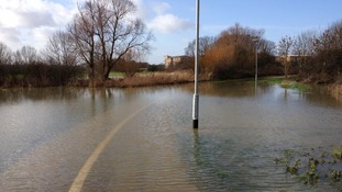 A cycle path underwater near the river Chelmer