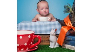 Elsa, 18 weeks, recreates Alice in Wonderland