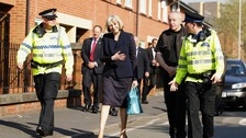 Home Secretary Theresa May walks around the St George's Estate in Hulme