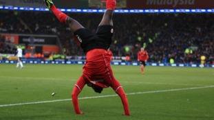 Kenwyne Jones is head over heels after scoring Cardiff's winning goal.
