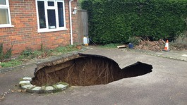 Family car disappears down a 30ft sinkhole in driveway
