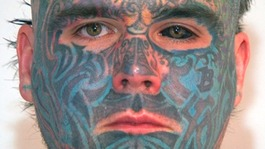 Tattoo covered man refused passport over name change