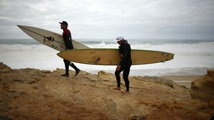 Big-wave surfers Garrett McNamara (R) of the U.S. and Andrew Cotton of Britain