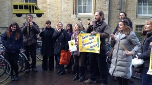 Parents protest against proposals to cut free school bus services