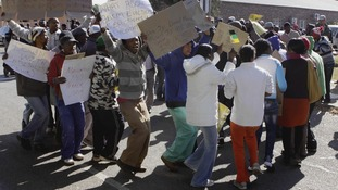 Protesters demonstrate outside the court in Ventersdorp, South Africa,