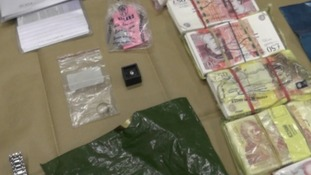 Cash, diamonds and designer watches were found in raids on safe deposits boxes.