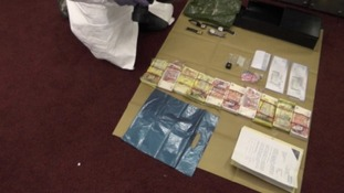 Cash and diamonds were found in raids on safe deposits boxes.