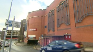 A woman has fallen to her death from a Rochdale shopping centre car park roof.