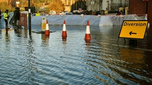 River defence barriers are put in place as the river Avon in Bristol.