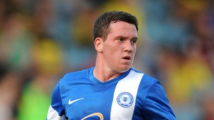 Posh midfielder Danny Swanson spotted the fan in distress.