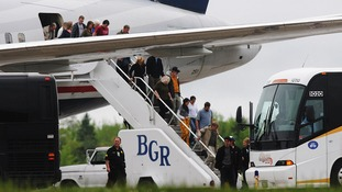 Passengers de-plane a trans-atlantic flight originating in France on the tarmac at Bangor International Airport