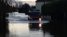 Somerset village evacuated after flood defences breached