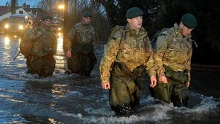 Members of 40 Commando Royal Marines arrive in Moorland, Somerset