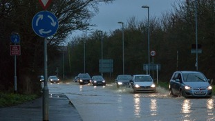 Traffic struggles to battle through the floodwater in Saffron Walden earlier this morning.