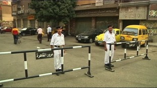 Guards outside a polling station in Cairo