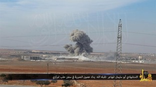 Syrian TV footage showing the blast at the prison near Aleppo