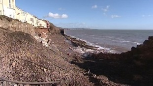 A large section track has been undermined by large waves