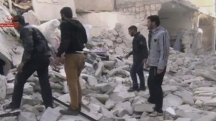 Civilians at the site of Aleppo prison after the attack