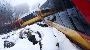 A French tourist train was derailed in the French Alps after being hit by a falling rock