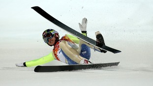 Korean Heung-Chui Choi falls during a jump prior to the Men's Normal Hill Individual Qualification Round