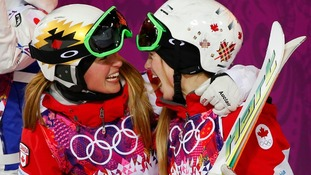Canadian sisters Chloe Dufour-Lapointe (left) and Justine Dufour-Lapointe come second and first in the freestyle skiing moguls final