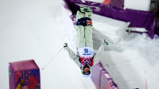 Australia's Britteny Cox performs a jump during the women's freestyle skiing moguls final