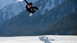 Austria's Clemens Schattschneider performs a jump during the men's snowboard slopestyle semi-final