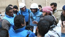 UN members talk with Sheikh Abu Harith al-Khalidi who is in charge of negotiations in the besieged city of Homs.