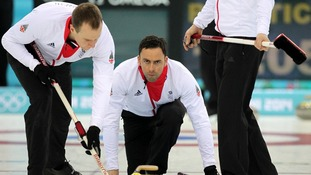 Great Britain's David Murdoch (C) with Michael Goodfellow (L) during curling training at the Ice Cube Curling Centre.
