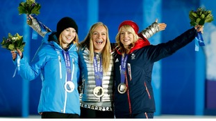 Jenny Jones (right) poses with her fellow medallists in the women's snowboard slopestyle event.