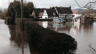 The Rose & Crown pub, in Severn Stoke, is flooded