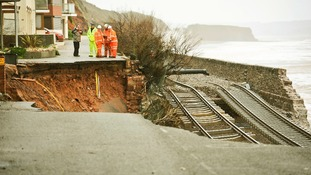 A section of the track at Dawlish was undermined by large waves, cutting off Cornwall and parts of Devon