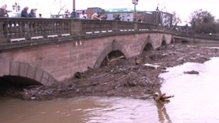 The River Severn is almost at the tops of the arches of Worcester Bridge