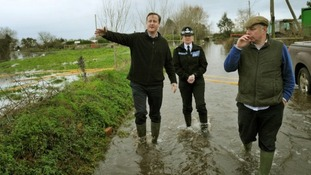 David Cameron with Bridgwater and West Somerset MP Ian Liddell-Grainger (right) during a visit to Goodings Farm in Fordgate, Somerset
