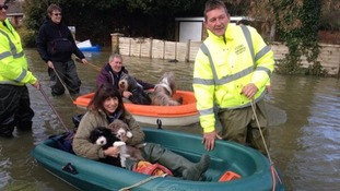 Volunteers towing residents of Wraysbury in Berkshire to safety