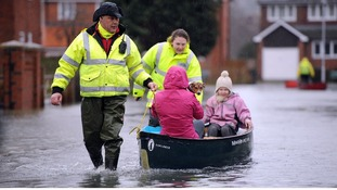 Volunteers help residents brave the flood water in Purley on Thames