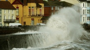 Waves crash into the coast at Dawlish in Devon