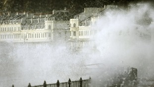 Spray is sent flying over the promenade in Dover