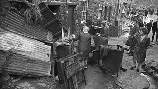 Residents of Pensford in Somerset clean up debris left by the flooding of 1968.